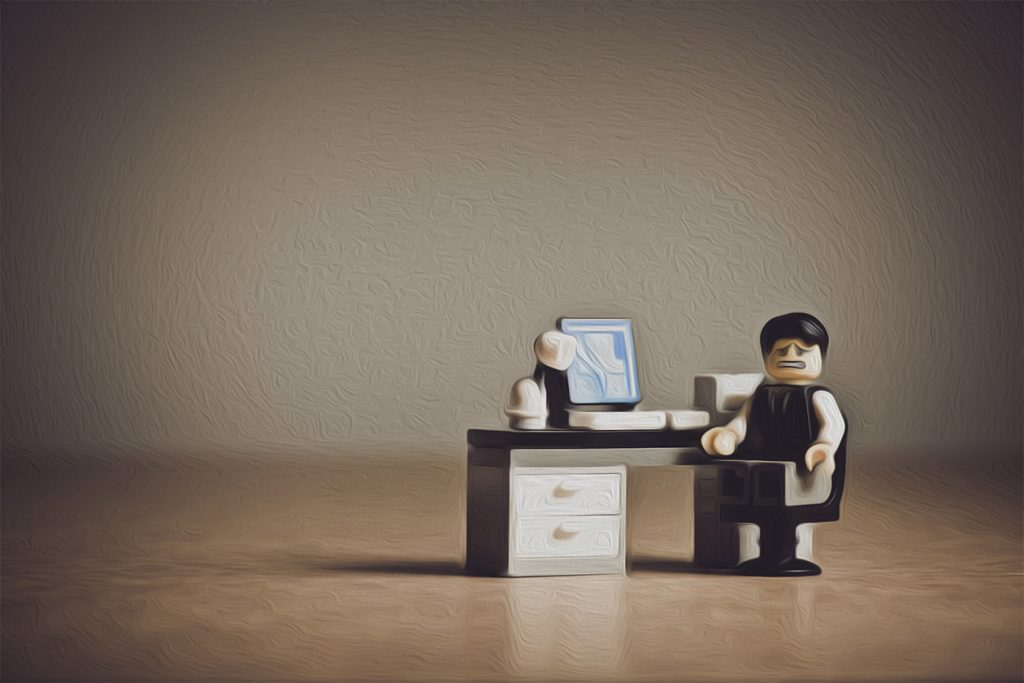 lego man in office despairing at his distraction and stress