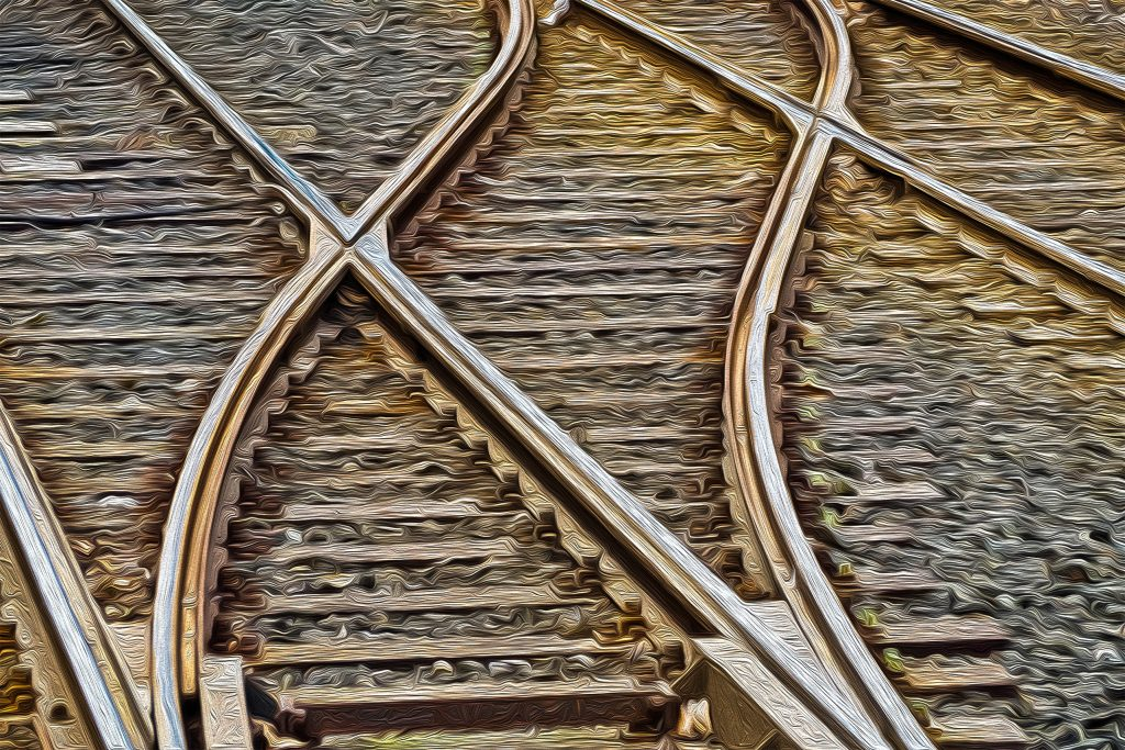 image of train tracks splitting illustrating the change of our use of the word ego