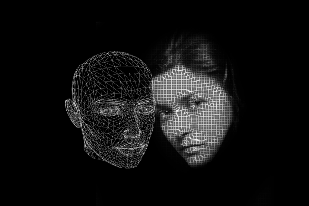 Black and white image of a womans face and a vector outline of a human head beside each other against a black background.