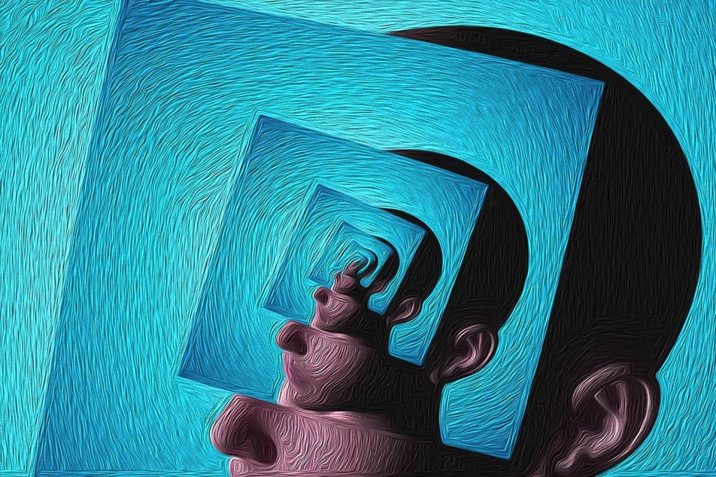 Image of a persons head with the same image within and the same image within that showing nested layers of the same image representing the layers of the conscious, subconscious and unconscious